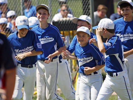 Morristown National celebrates a win against Tri-Town in a Little League Baseball District 1 Tournament at Burnham Park, July 05 2014. Morristown NJ. photo by Kathy Johnson MOR 0706 LL baseball