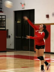 Loving's Jacqueline Pierce serves the ball in the first