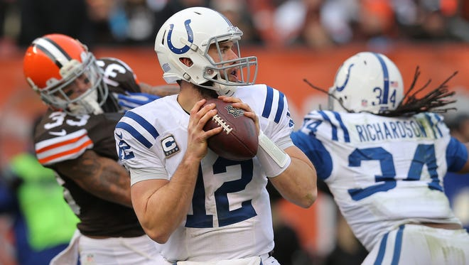 Indianapolis Colts quarterback Andrew Luck (12) looks for a receiver  in the second half of the game against the Browns on Dec. 7, 2014. The Colts won 25-24.