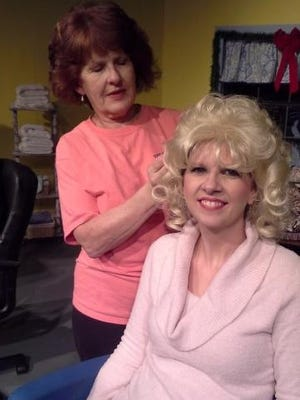 Truvy (Debbie Carr) offers beauty advice to Shelby (Nicole Hull).