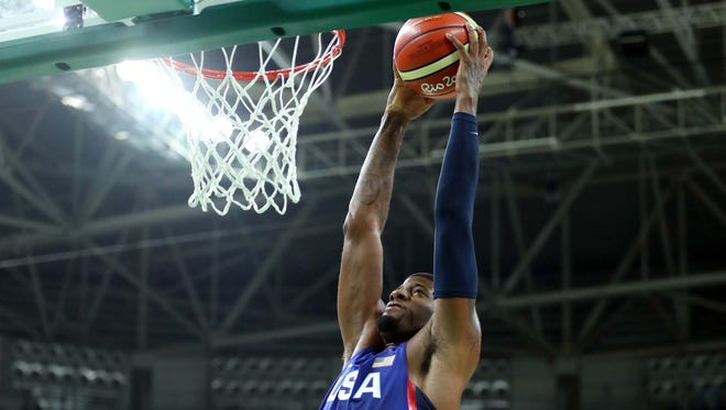 Aug 6, 2016; Rio de Janeiro, Brazil; United States guard Paul George (13) dunks the ball against China forward Gen Li (12) in the men's basketball group A  preliminary round during the Rio 2016 Summer Olympic Games at Carioca Arena 1.