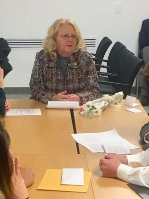 Students from Animas High School work with State Rep. Candie Sweetser in preparation for  testimony for a mock hearing at the New Mexico Legislature.