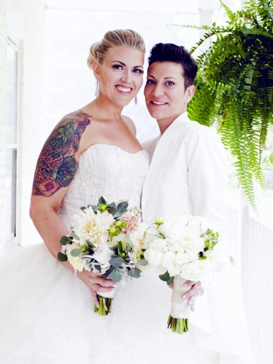 Morgan Levine and Cameron Romer are shown in this wedding photo.