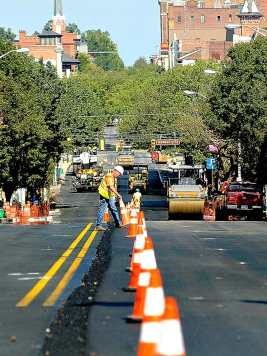Crews work Tuesday to pave West Market Street in downtown York. The work is expected to be finished by mid-November.