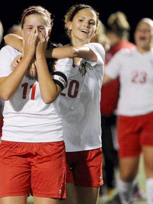 Susquehannock's Brooke McGee, left, celebrates with teammate Melissa Lynch after scoring the winning goal during the Warriors' 1-0 overtime win against Eastern York in October. McGee was told she might not be able to play sports because of her Crohn's disease, but she has excelled. She's set to play Division I soccer at the New Jersey Institute of Technology next season as she pursues a degree in chemical engineering.