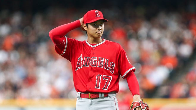 Shohei Ohtani strikes out seven, walks five in start vs. Astros.