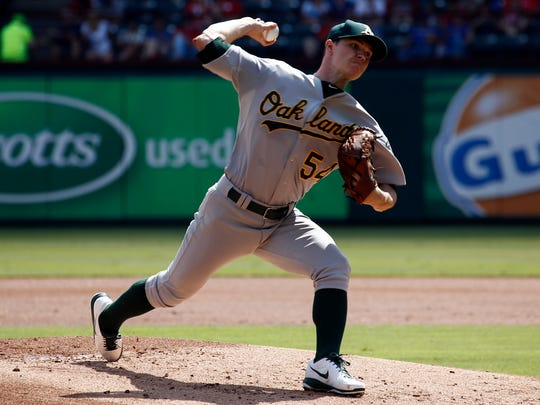 Sep 28, 2014; Arlington, TX, USA; Oakland Athletics starting pitcher Sonny Gray (54) delivers a pitch to the Texas Rangers during the first inning of a baseball game at Globe Life Park in Arlington. Mandatory Credit: Jim Cowsert-USA TODAY Sports