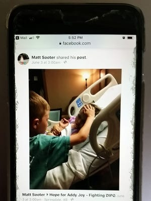Matt Sooter of Rogers, Ark., snapped a picture of a heartbreaking moment between his daughter in hospice care and his son and shared it publicly June 2, 2018, on Facebook. It went viral.