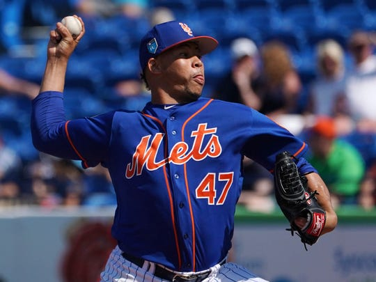 New York Mets relief pitcher Hansel Robles (47) delivers a pitch in the third inning against the Washington Nationals during a spring training game at First Data Field.
