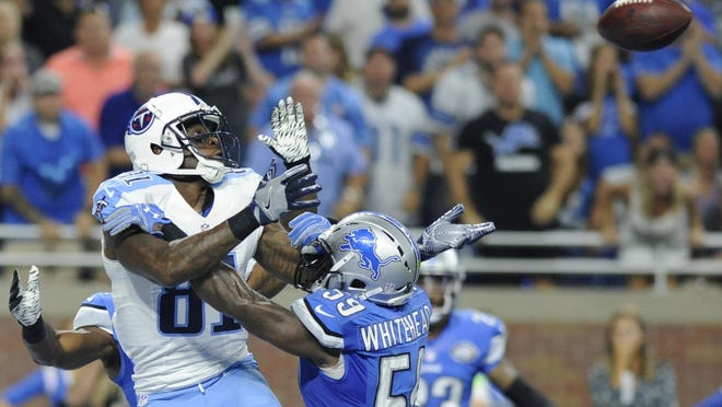 Titans wide receiver Andre Johnson (81), defended by Lions middle linebacker Tahir Whitehead (59), catches a 9-yard pass in the fourth quarter Sunday.