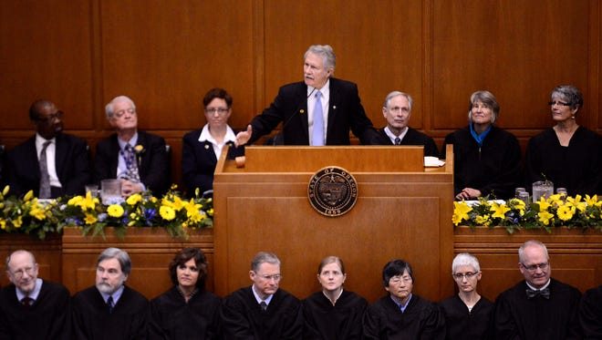 Oregon Gov. John A. Kitzhaber addresses the joint session inside the senate chambers after being sworn in to his historic fourth term during the first day of the 2015 Oregon Legislature at the state Capitol building on Monday, January 12, 2015, in Salem.