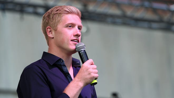 IndyCar driver Spencer Pigot makes an appearance at Curt Cavin's annual Carb Night Burger Bash, held Downtown at the Pan American Plaza, May 27, 2016.
