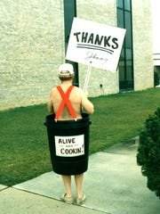 In 1989 Johnny Hunstman took a very personal approach to ask customers to support his business. He stood at a busy intersection wearing a barrel and waving at passing commuters.