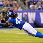 Giants linebacker Uani' Unga intercepts a pass in the third quarter against the Washington Redskins at MetLife Stadium on  Thursday.
