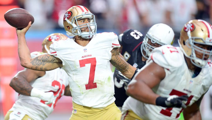 Sep 21, 2014: San Francisco 49ers quarterback Colin Kaepernick (7) throws the ball against the Arizona Cardinals during the second half at University of Phoenix Stadium. The Cardinals won 23-14.