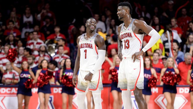 Feb 10, 2018; Tucson, AZ, USA; Arizona Wildcats guard Rawle Alkins (1) and forward Deandre Ayton (13) laugh during the second half against the Southern California Trojans at McKale Center. Mandatory Credit: Casey Sapio-USA TODAY Sports