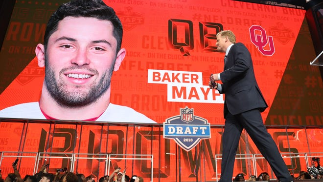 NFL commissioner commissioner Roger Goodell walks off stage as Baker Mayfield is selected as the number one overall pick by Cleveland in the first round of the 2018 NFL Draft