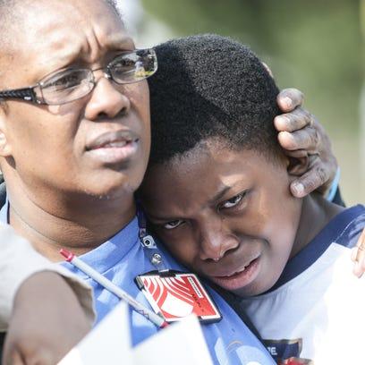 Deborah Cooper comforts her grandson William Wilson