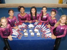 """Lillian McClellan, 9, was first in the all-around in her age group and also first in the all-around in all of the age groups that competed """"Level 4"""" at Aloha Gymfest Meet."""