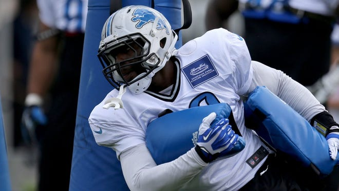 Detroit Lions defensive end George Johnson goes through drills during practice July 31, 2014, in Allen Park.