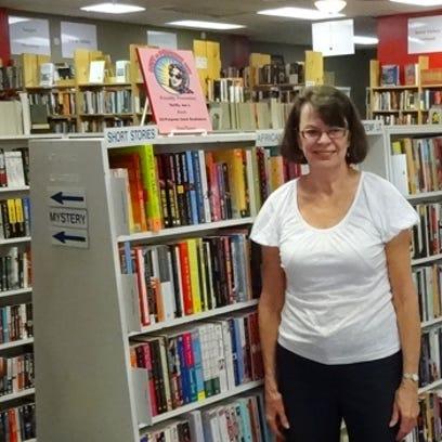 Jan Lehrack inside Thrifty Joe's Books & Music in north