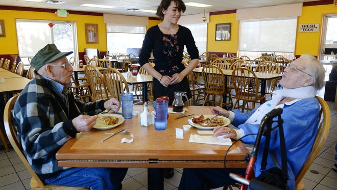 Waitress Sara De Nolf checks on Doug and Audrey Weitzel at Farmer's Table on Dec. 28. The Fort Collins mainstay reopened in December under new ownership.
