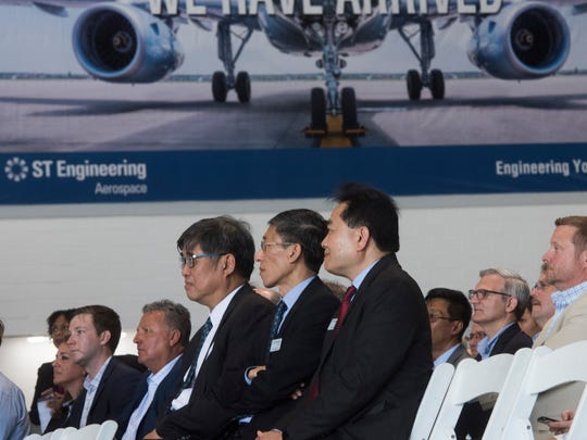 Executives from ST Engineering Aerospace in Singapore look on during the grand opening of the company's new VT MAE facility at the Pensacola Internation Airport on Friday, June 8, 2018.