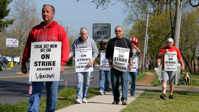 Verizon workers picket outside of the Verizon location on Shrewsbury Avenue in Tinton Falls, NJ Monday, April 18, 2016.