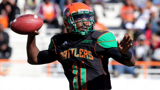 Florida A&M's Damien Fleming looks for an open receiver during the first quarter of an NCAA college football game against Norfolk State, Saturday, Nov. 1, 2014, in Tallahassee Fla. (AP Photo/Steve Cannon)