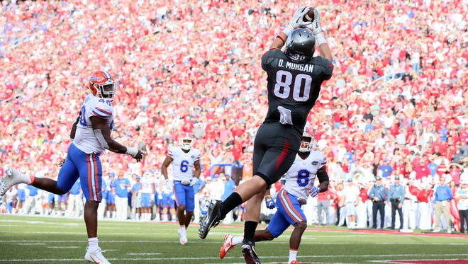 Arkansas wide receiver Drew Morgan catches a pass for a touchdown during the second quarter against Florida at Donald W. Reynolds Razorback Stadium.