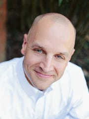 Adam Helton is a Realtor and broker with Benchmark