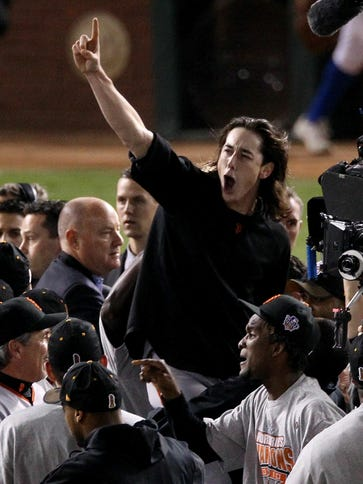 Tim Lincecum celebrates with his teammates after the