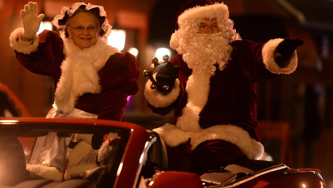 Santa and Mrs. Claus ride in the Christmas in Centerville parade Saturday, Dec. 6, 2014.