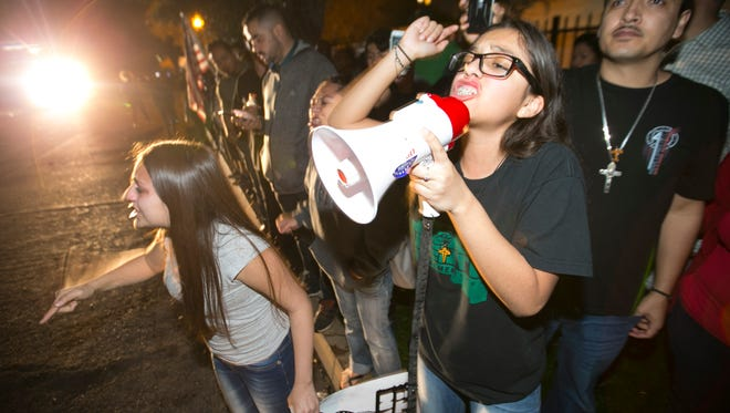 Jacqueline Rayos Garcia, the daughter of Guadalupe Garcia de Rayos protests outside ICE headquarters in Phoenix on Feb. 8, 2017.