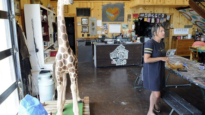 Keelie Wurster talks about her business' involvement in helping to renew the miniature golf course in Brookside Park. The giraffe and rock are items that are being painted at Tin Can Chandelier to be added to the course.