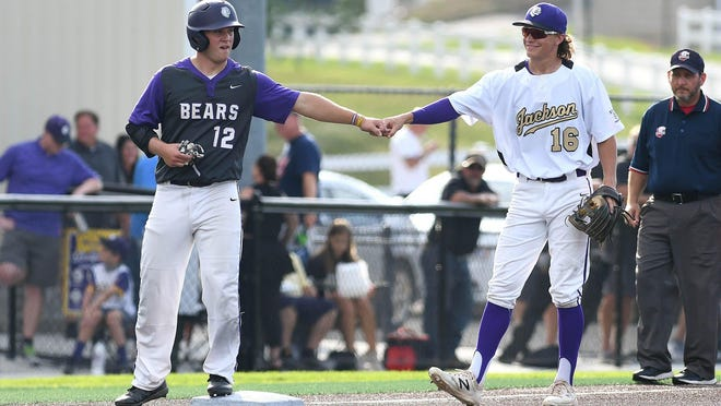 Jackson graduates Ben Hymes (12) and Josh Romans found themselves on opposite teams for the Federal League senior baseball doubleheader at Jackson on Saturday.
