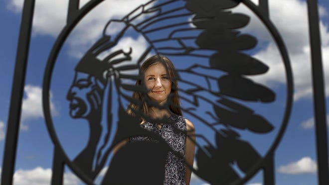 Allison Booher, a 2017 graduate of Canal Winchester High School, stands outside the stadium at the school, whose nickname is the Indians. Booher organized a petition drive that has collected 3,000 signatures supporting changing the nickname.