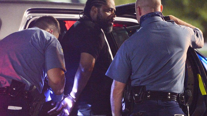 A man was arrested by Massachusetts State Police officers in front of Best Buy at the Westgate Mall in Brockton, with a 9mm gun on Wednesday, Sept. 2, 2020.