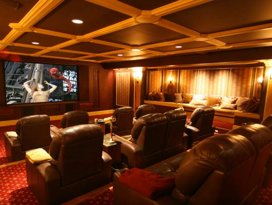 A home theater designed by Finished Basements New Jersey.
