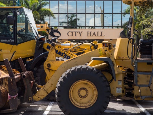 Large construction vehicles and machines were prepositioned outside of the Marco Island City Hall on Friday, Sept. 8, 2017 in anticipation of Hurricane Irma's aftermath.