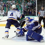 Blues goalie Brian Elliott blocks a shot on goal against the Dallas Stars in the first period in Game 1 on Friday night.