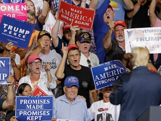 Supporters cheers for President Donald Trump as he