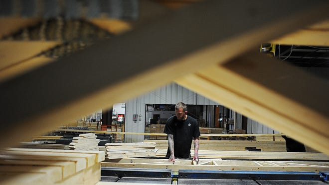 Keith Palmer, a floor truss builder at Engineered Truss Systems Inc., puts together a residential floor truss Wednesday, Nov. 4, 2015, at Engineered Truss Systems Inc. in Sioux Falls.