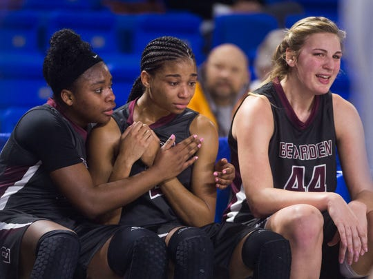 Bearden's Tytiaira Spikes (32) comforts Bearden's Trinity Lee (2) while sitting on the bench with Bearden's Grace van Rij (44) during a TSSAA Class AAA  state semifinal girls basketball game between Bearden and Riverdale at Middle Tennessee State University in Murfreesboro, Tenn. Friday, March 9, 2018.