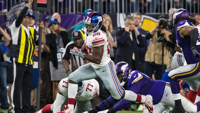 New York Giants running back Paul Perkins (28) carries the ball during the fourth quarter against the Minnesota Vikings at U.S. Bank Stadium. The Vikings defeated the Giants 24-10.