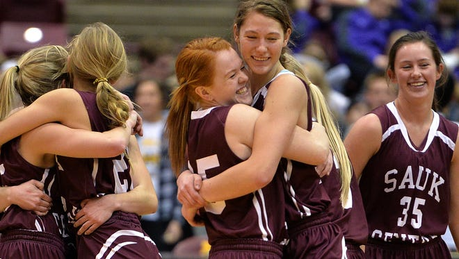 Sauk Centre teammates celebrate their 70-51 victory over Norwood-Young America after the second half of the Class 2A girls basketball tournament quarterfinal game Wednesday at the University of Minnesota's Mariucci Arena in Minneapolis. The Mainstreeters victory sends Sauk Centre to Friday's semifinal game at Williams Arena.