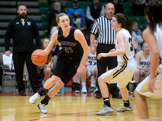 Missoula Sentinel's Jordyn Schweyen drives to the basket.