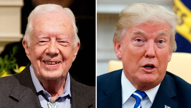 Former president Jimmy Carter and President Trump.