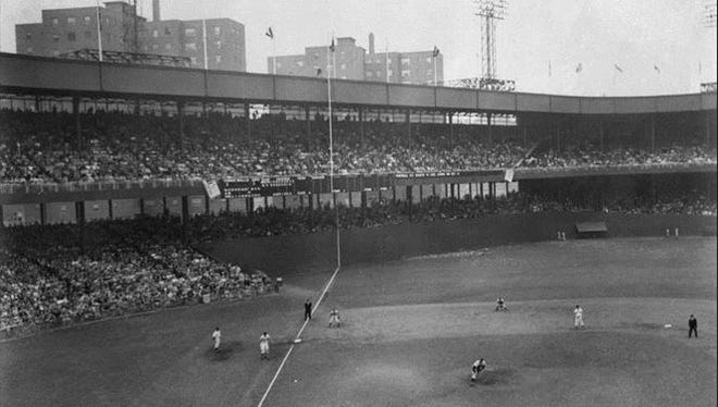 In this Oct. 3, 1951, file photo, Bobby Thomson of the New York Giants hits a home run off Brooklyn Dodgers pitcher Ralph Branca in a playoff baseball game at the Polo Grounds in New York.