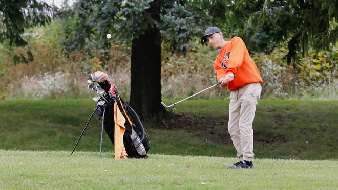 Freeport freshman Zach Newcomer chips onto the green on the ninth hole at Elliot Golf Course in Saturday's final round of the NIC-10 boys golf tournament in Rockford. Newcomer shot 93 and the Pretzels finished ninth.